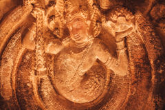 Myth creature on stone relief carvings of the 7th century temple`s ceiling, Aihole town of Karnataka. Asian artwork Stock Photo