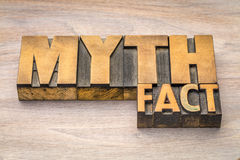 Myth and fact word in wood type. Myth and fact word abstract in letterpress wood type printing blocks against grained wood royalty free stock images