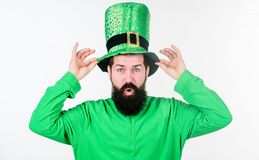 Myth of leprechaun. Man bearded hipster wear green clothing and hat patricks day. Saint patricks day holiday. Green. Color part of celebration. Happy patricks royalty free stock photography