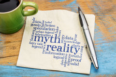 Myth and reality word cloud. Myth versus reality word cloud - handwriting on a napkin with cup of coffee Stock Photo
