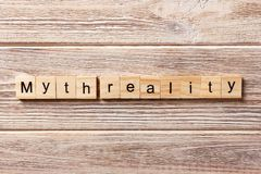 Myth reality word written on wood block. Myth reality text on table, concept.  Royalty Free Stock Photo