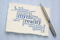 Myth versus reality word cloud. Handwriting on a sheet of rough Khadi paper stock image