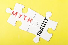 Myth vs reality. Myth and reality words on two pieces of puzzle Royalty Free Stock Image