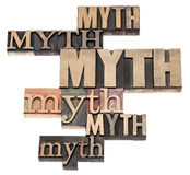 Myth word abstract. Isolated text in a variety of vintage letterpress wood type printing blocks royalty free stock photo