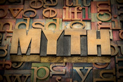 Myth word in wood type. Against background of letterpress printing blocks royalty free stock images