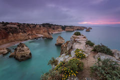 Mythic sunrise on the beach Marinha. Portugal Royalty Free Stock Image