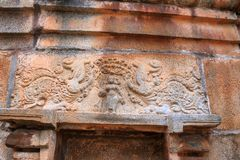 Mythical animal, Makara and Yakshi figure carved on a wall, Panchakuta Basadi or Panchakoota Basadi Kambadahalli, Mandya district,. Mythical animal, Makara and Stock Photo