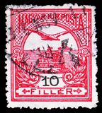 Mythical bird Turul flying over Crown of St. Stephen, serie, circa 1913. MOSCOW, RUSSIA - MARCH 23, 2019: A stamp printed in Hungary shows Mythical bird Turul royalty free stock image