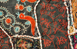 Mythical birds and unusual patterns on traditional Indian patchwork handmade carpet. Royalty Free Stock Image
