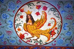 Mythical creature. Painting on the facade of wooden palace