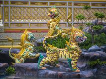 Mythical creatures of Himvanta. Bangkok, Thailand, November 11, 2017 : Lion-like mythical creatures of Himvanta around The Royal crematorium of King Rama IV Royalty Free Stock Image