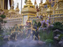 Mythical creatures of Himvanta. Bangkok, Thailand, November 11, 2017 : Lion-like mythical creatures of Himvanta around The Royal crematorium of King Rama IV Royalty Free Stock Photography