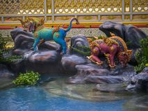 Mythical creatures of Himvanta. Bangkok, Thailand, November 11, 2017 : Lion-like mythical creatures of Himvanta around The Royal crematorium of King Rama IV Stock Photo