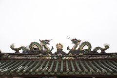 Mythical creatures statue on roof of Guandi shrine and Jinping Temple of Queen of Heaven at Shantou or Swatow in Guangdong, China. Mythical creatures statue on royalty free stock image