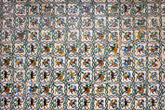 Mythical Creatures Tiled Wall Background. Historic tiled wall with satyrs, centaurs, goats and other mythical creatures, Real Alcazar, Seville, Spain, Andalusia Stock Image