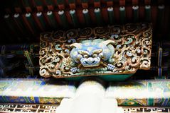 Mythical creatures under the eaves. There are so many mythical creatures under the eaves or on the door in Forbidden City. Photo shot in Beijing, China stock photos