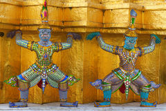 Mythical demon figures. At the temple of the king in the Grand Palace, Bangkok, Thailand Royalty Free Stock Photo