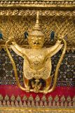 Mythical gold Buddhist statue Royalty Free Stock Image