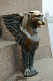 Mythical monster in bronze. Four of Griffin located on the sides of the granite pier Universitetskaya embankment (Saint-Petersburg) on the Neva river royalty free stock photos