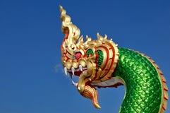 Mythical Naga soaring into blue sky Stock Photos