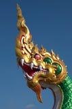 Mythical Naga soaring into blue sky Royalty Free Stock Photography