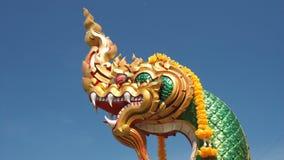 Mythical Naga soaring into blue sky Royalty Free Stock Photos