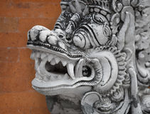 Mythical personage Barong from Balinese epos. Image of mythical personage Barong from Balinese epos with orange wall on background Stock Photos