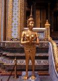 Mythical statue, Grand Palace, Bangkok. Golden half woman half creature statue at the Grand Palace (Phra Borom Maha Ratcha Wang), Bangkok, Thailand, Far East Royalty Free Stock Images