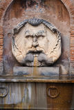 Mythologic face. Mythologic monster face in a fountain in Rome,Italy Stock Photos