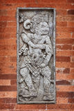 Mythological character on wall of the temple. Indonesia, Bali Royalty Free Stock Photos