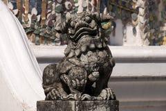 Mythological chinese style lion or dragon guarding the Phra Viharn Yod temple stock photo