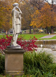 Mythological classical statue in public park Stock Photos