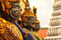Mythological figure of the indian epic ramayana,. The demon guardian, guarding the buddhist temple in the grand palace, Bangkok Royalty Free Stock Photography