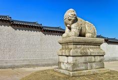 Mythological lion Haechi statue at Gyeongbokgung Palace gate in Seoul Stock Image