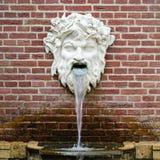 mythological skulptur för springbrunn Arkivbild