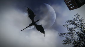 Mythologischer Drache, der über eine mittelalterliche Dorfgesamtlänge fliegt