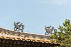 Mythology birds. The horizontal view of the mythology birds on the roof Royalty Free Stock Photography