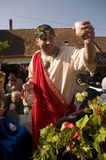 The mythology god of wine Bacchus. PEZINOK,SR - SEPTEMBER 28: The mythology god of wine Bacchus is raising the glass of wine at the allegorical procession during Stock Photography