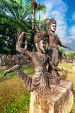 Mythology and religious statues at Wat Xieng Khuan Buddha park. Stock Photos