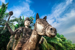 Mythology and religious statues at Wat Xieng Khuan Buddha park. Royalty Free Stock Photography