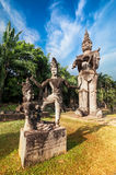 Mythology and religious statues at Wat Xieng Khuan Buddha park. Stock Photo