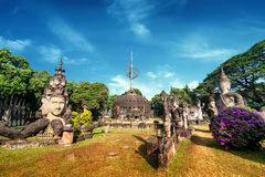Mythology and religious statues at Wat Xieng Khuan Buddha park. Royalty Free Stock Photo
