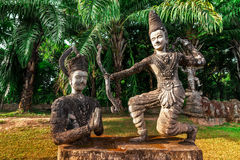 Mythology and religious statues at Wat Xieng Khuan Buddha park. Stock Image