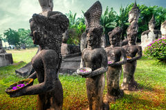 Mythology and religious statues at Wat Xieng Khuan Buddha park. Stock Photography