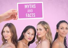 Myths and facts Text and Hand holding card with pink breast cancer awareness women royalty free stock images