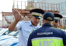 Inspectors of the road police patrol service specify the details of the forthcoming raid. MYTISHCHI, RUSSIA - AUGUST 12, 2017: Inspectors of the road police royalty free stock photography