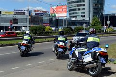 Inspectors of traffic police on motorcycles go on patrolling roads. MYTISHCHI, RUSSIA - AUGUST 12, 2017: Inspectors of traffic police on motorcycles go on Royalty Free Stock Photo