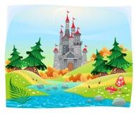 Mytologiskt landskap med den medeltida slotten. Arkivfoton