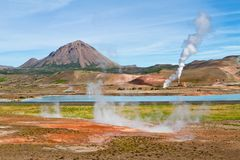 Myvatn geothermal area. Geothermal power station near the blue lake royalty free stock photo