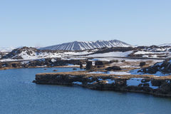 Myvatn volcano and lake with clear blue sky in winter of Iceland Royalty Free Stock Images